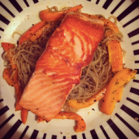 Salmon on a bed of spiced shiritaki noodles and orange capsicum