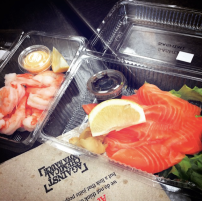 Salmon sashimi and cooked prawn tails