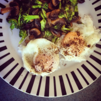 Fried broccoli and garlic mushrooms with fried eggs